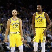 Curry, Durant lift Warriors over Clippers in NBA thr...